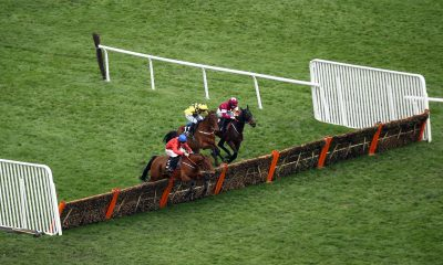 2B6M6NJ Davy Russell aboard Envoi Allen (nearside) on their way to winning the Ballymore Novices' Hurdle during day two of the Cheltenham Festival at Cheltenham Racecourse.