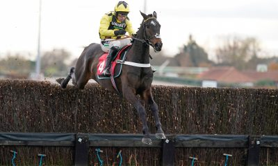 Shishkin and Nico de Boinville jumping a fence at Kempton Park Racecourse