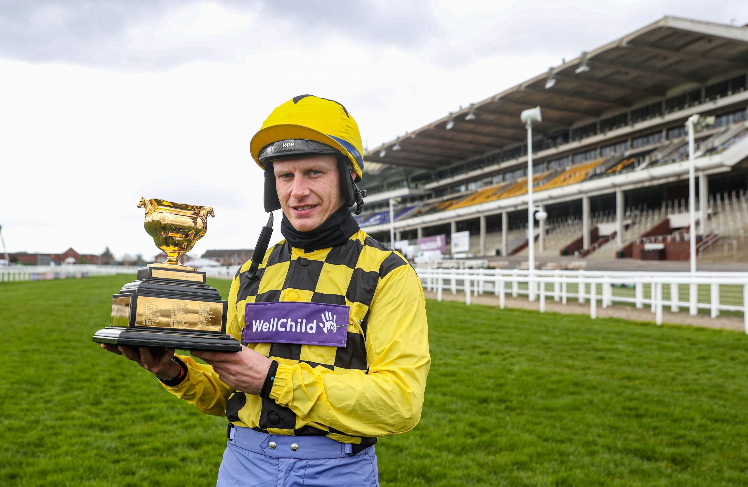 Paul Townend with The Gold Cup at Cheltenham Racecourse ahead of the Cheltenham Festival. Issue date: Tuesday March 16, 2021.