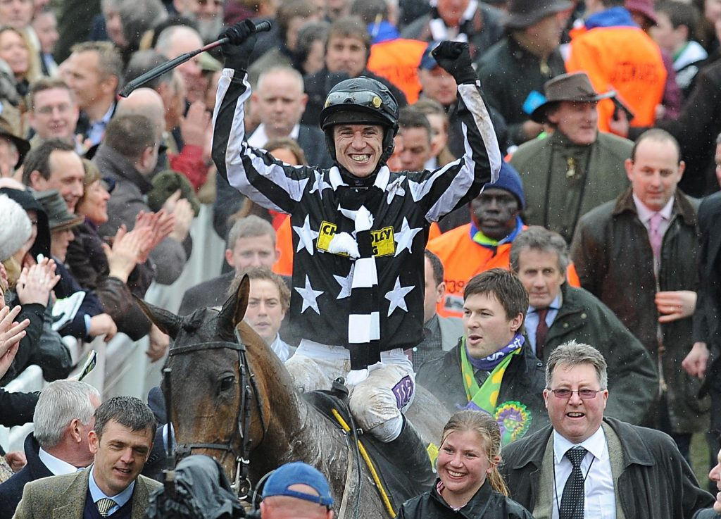 Paddy Brennan celebrates winning the totesport Cheltenham Gold Cup on Imperial Commander.