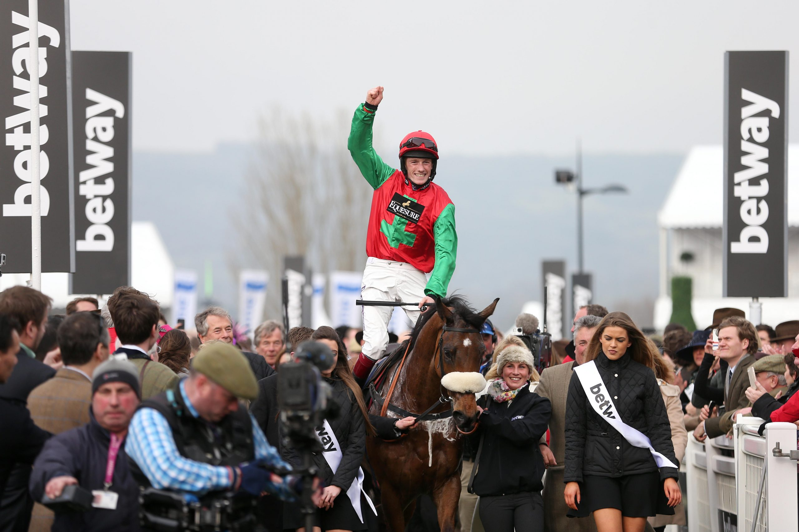 Jockey Sam Twiston-Davies celebrates on board Dodging Bullets after winning the Betway Queen Mother Champion Chase on Ladies Day during the Cheltenham Festival at Cheltenham Racecourse.