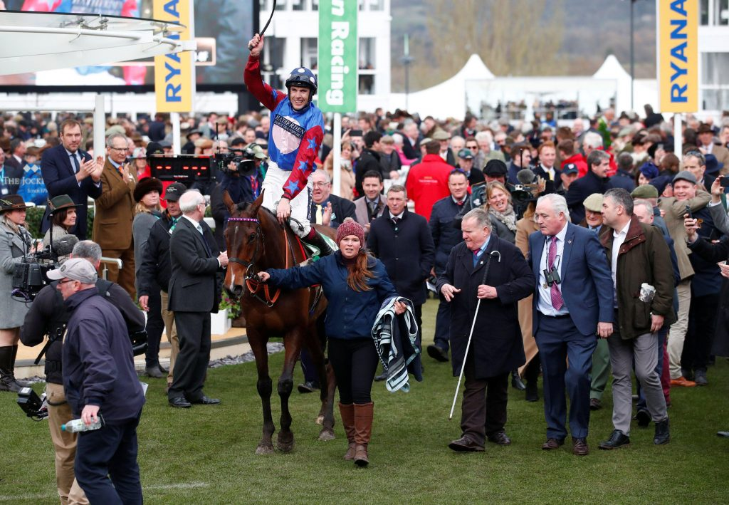 Aidan Coleman celebrates after Paisley Park wins the Stayers' Hurdle at the 2019 Cheltenham Festival