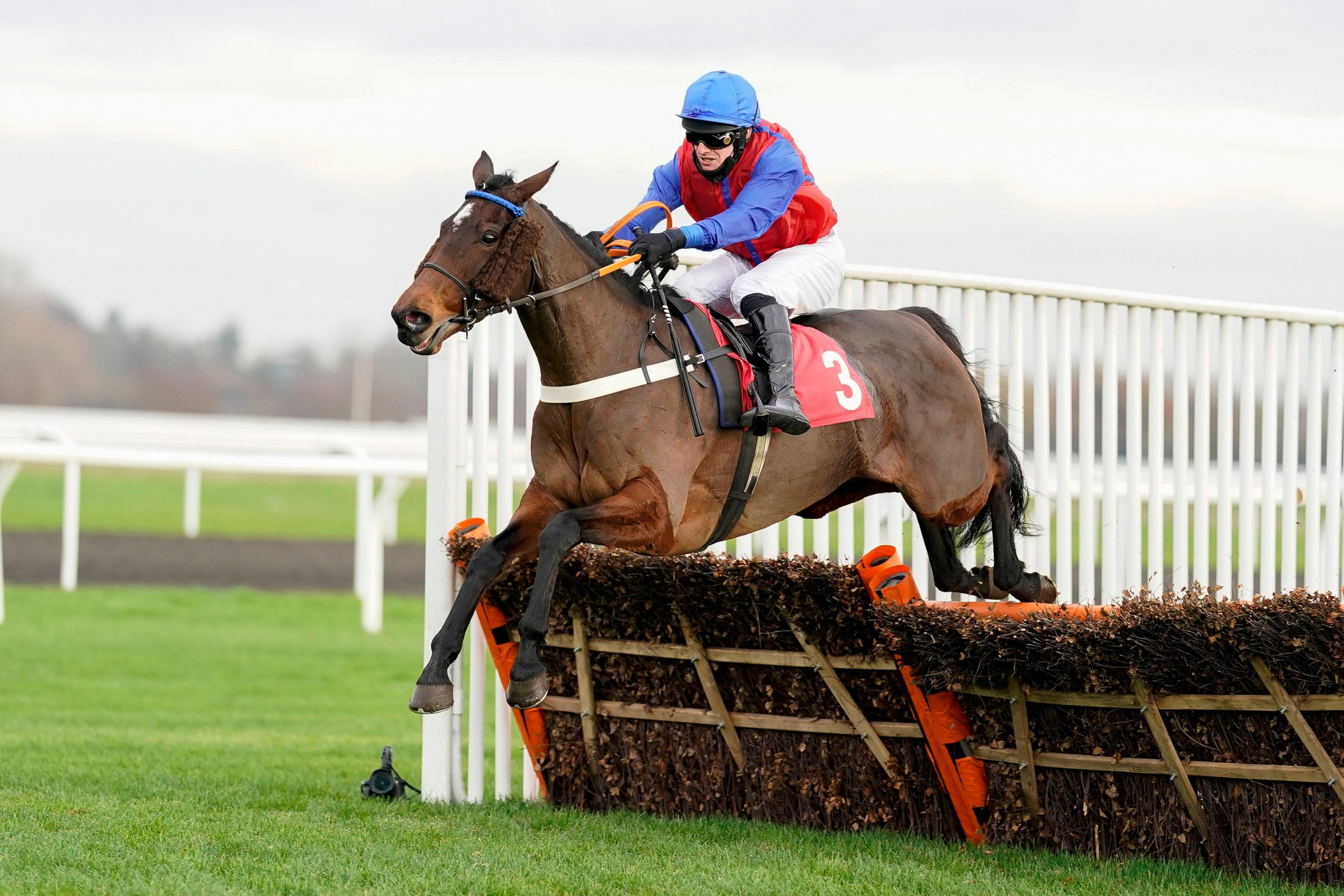 David Bass riding Bannixtown Glory clear the last to win The Racing TV Mares' Hurdle at Kempton Park Racecourse.