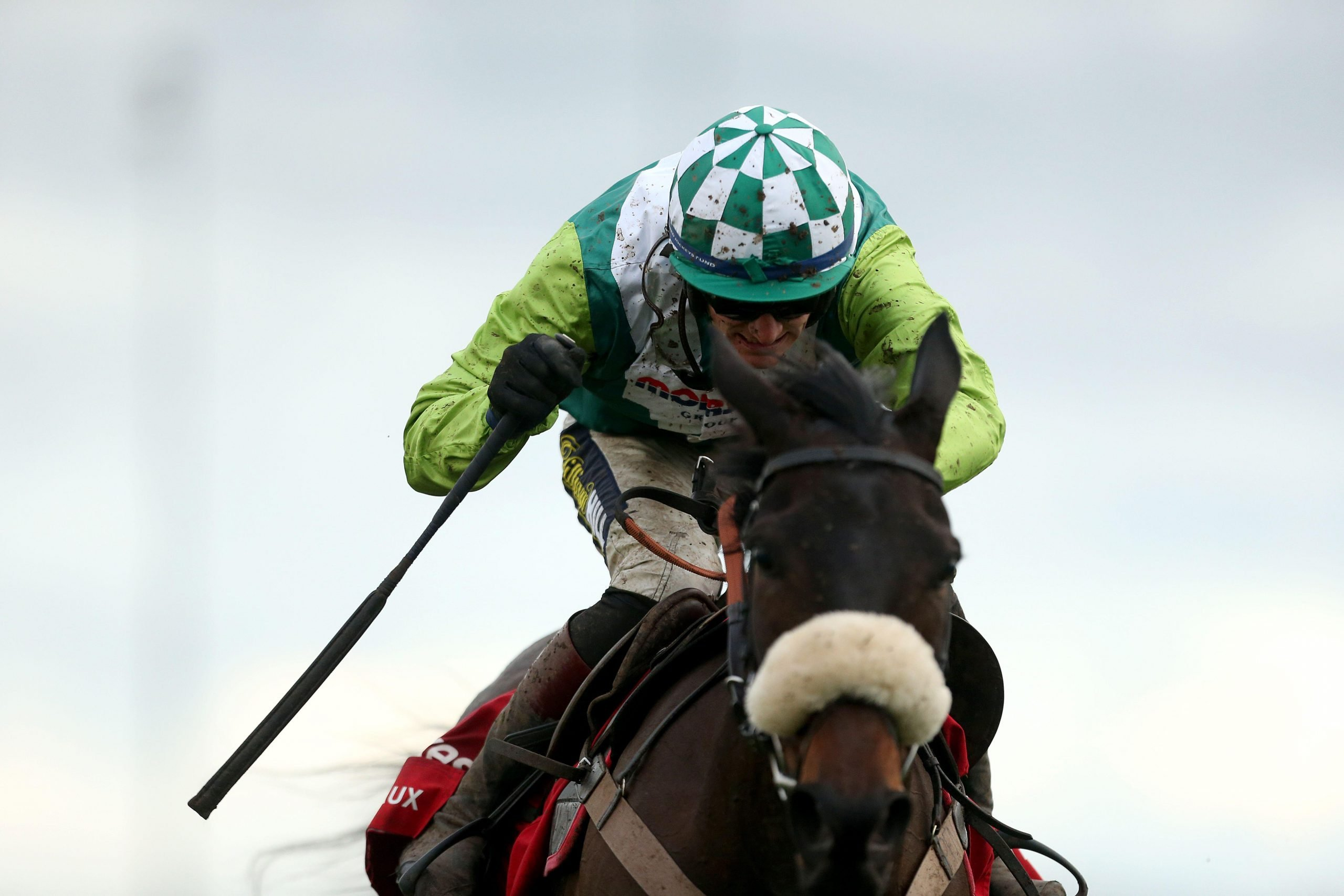 Clan Des Obeaux ridden by jockey Sam Twiston-Davies goes onto win the Ladbrokes King George VI Chase during day one of the Winter Festival at Kempton Park Racecourse.