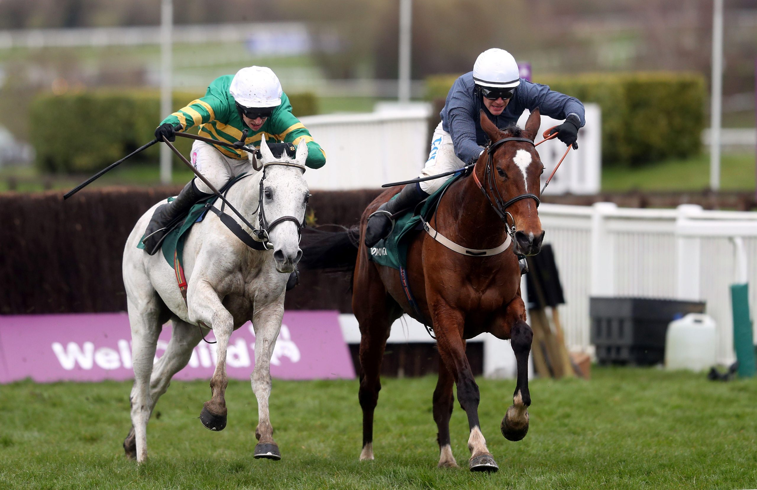 Colreevy ridden by jockey Paul Townend (right) on their way to winning the Mrs Paddy Power Mares' Chase ahead of Elimay and Mark Walsh (left) during day four of the Cheltenham Festival at Cheltenham Racecourse. Picture date: Friday March 19, 2021.