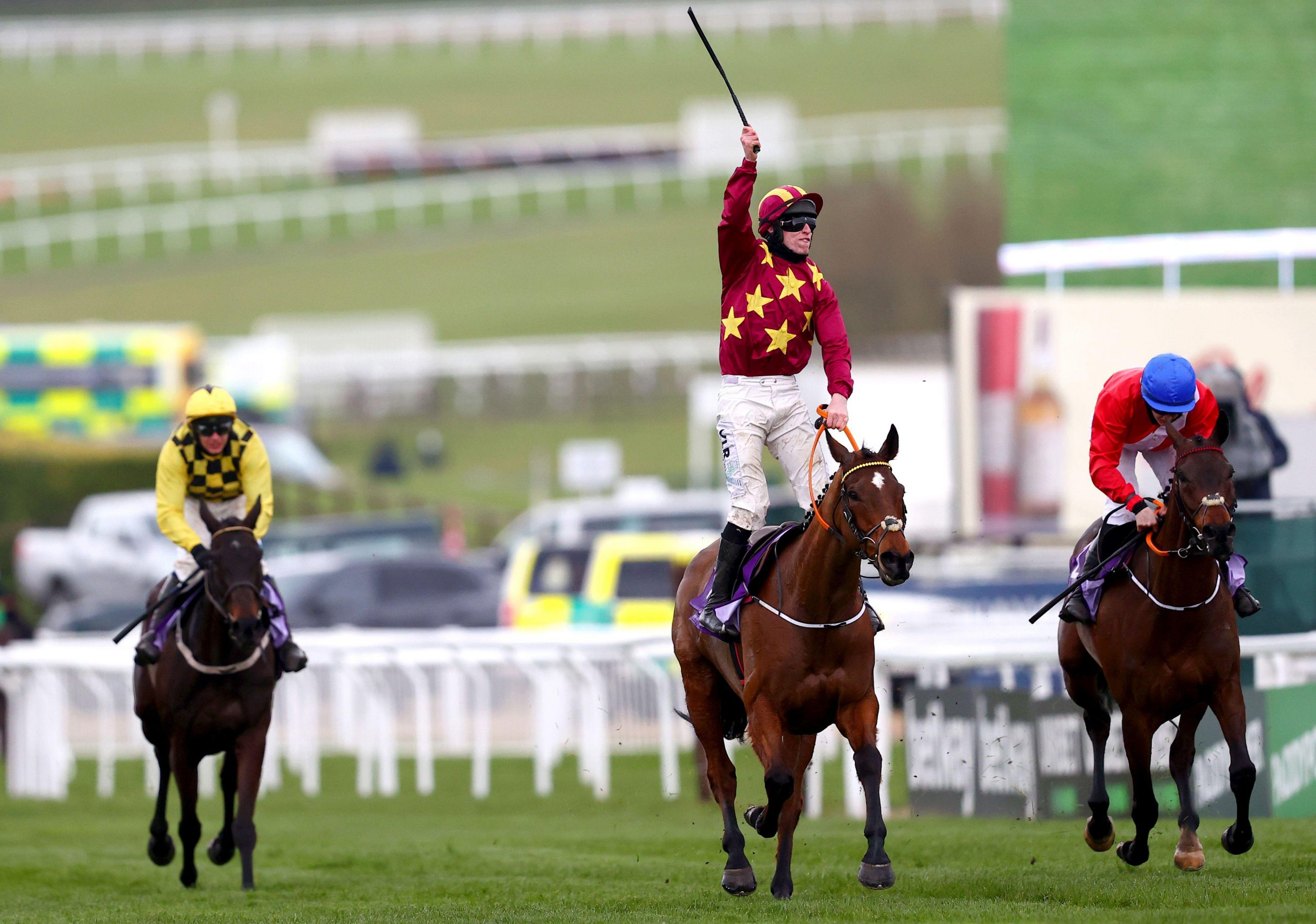 Jack Kennedy (second right) celebrates on top of Minella Indo after winning the WellChild Cheltenham Gold Cup Chase during day four of the Cheltenham Festival at Cheltenham Racecourse. Picture date: Friday March 19, 2021.