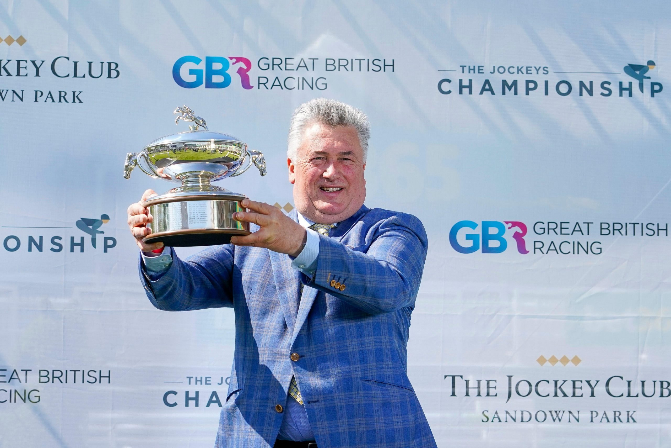 Paul Nicholls with his Champion Trainer trophy for the national hunt season 2020-21 at Sandown Park Racecourse, Esher. Picture date: Saturday April 24, 2021.