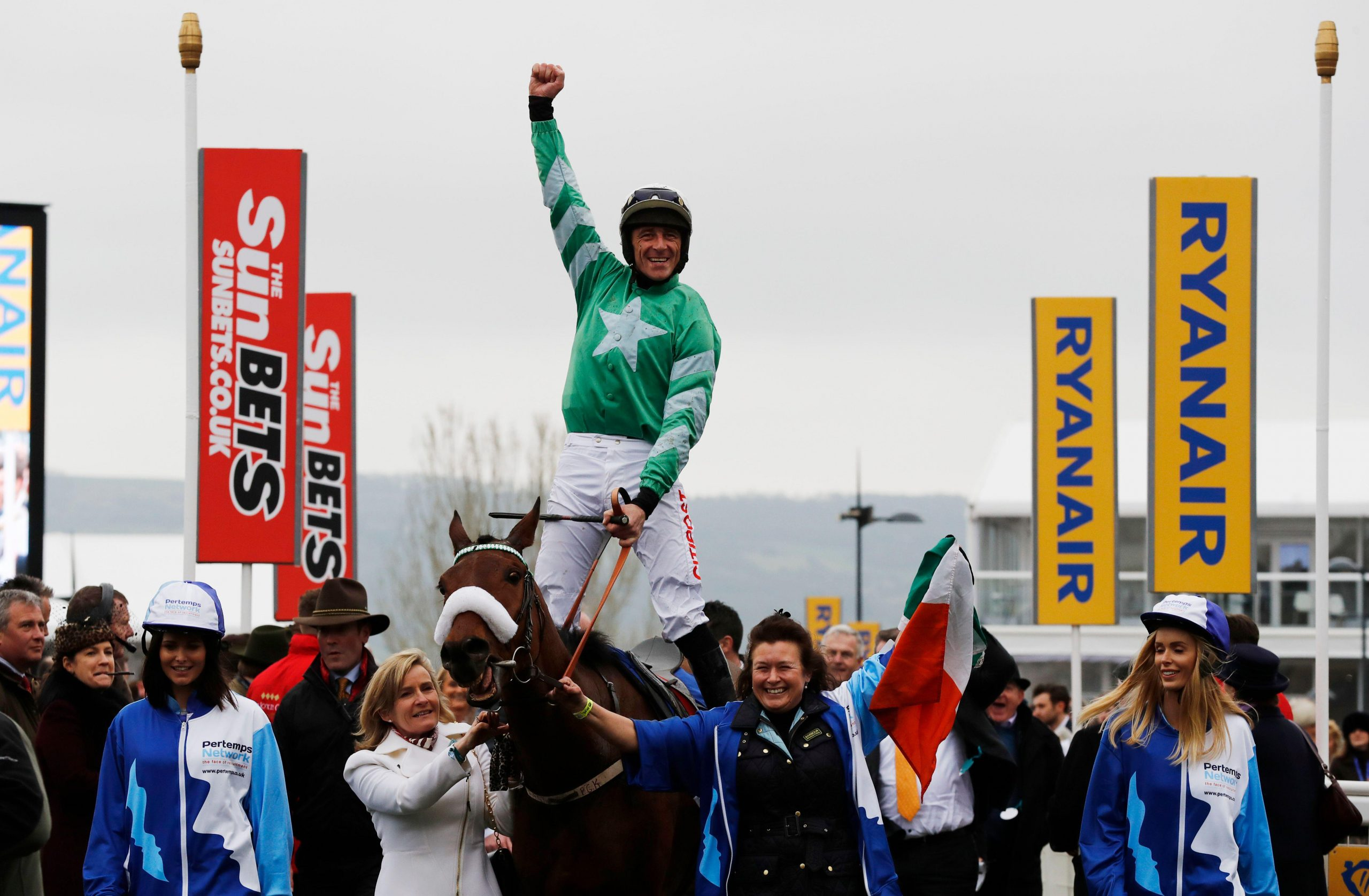 2EDJD03 Britain Horse Racing - Cheltenham Festival - Cheltenham Racecourse - 16/3/17 Davy Russell on Presenting Percy celebrates winning the 2.10 Pertemps Network Final Handicap Hurdle Reuters / Stefan Wermuth Livepic EDITORIAL USE ONLY.