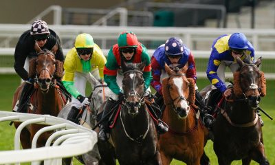 Max Kendrick riding Stoner's Choice (green/red) on their way to winning The Sky Sports Racing Conditional Jockeys' Handicap Hurdle at Ascot Racecourse. Picture date: Sunday March 28, 2021.