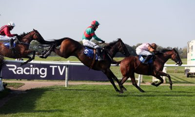 Templepark ridden by Max Kendrick (centre) on their way to winning the racingtv.com Handicap Chase at Warwick Racecourse.