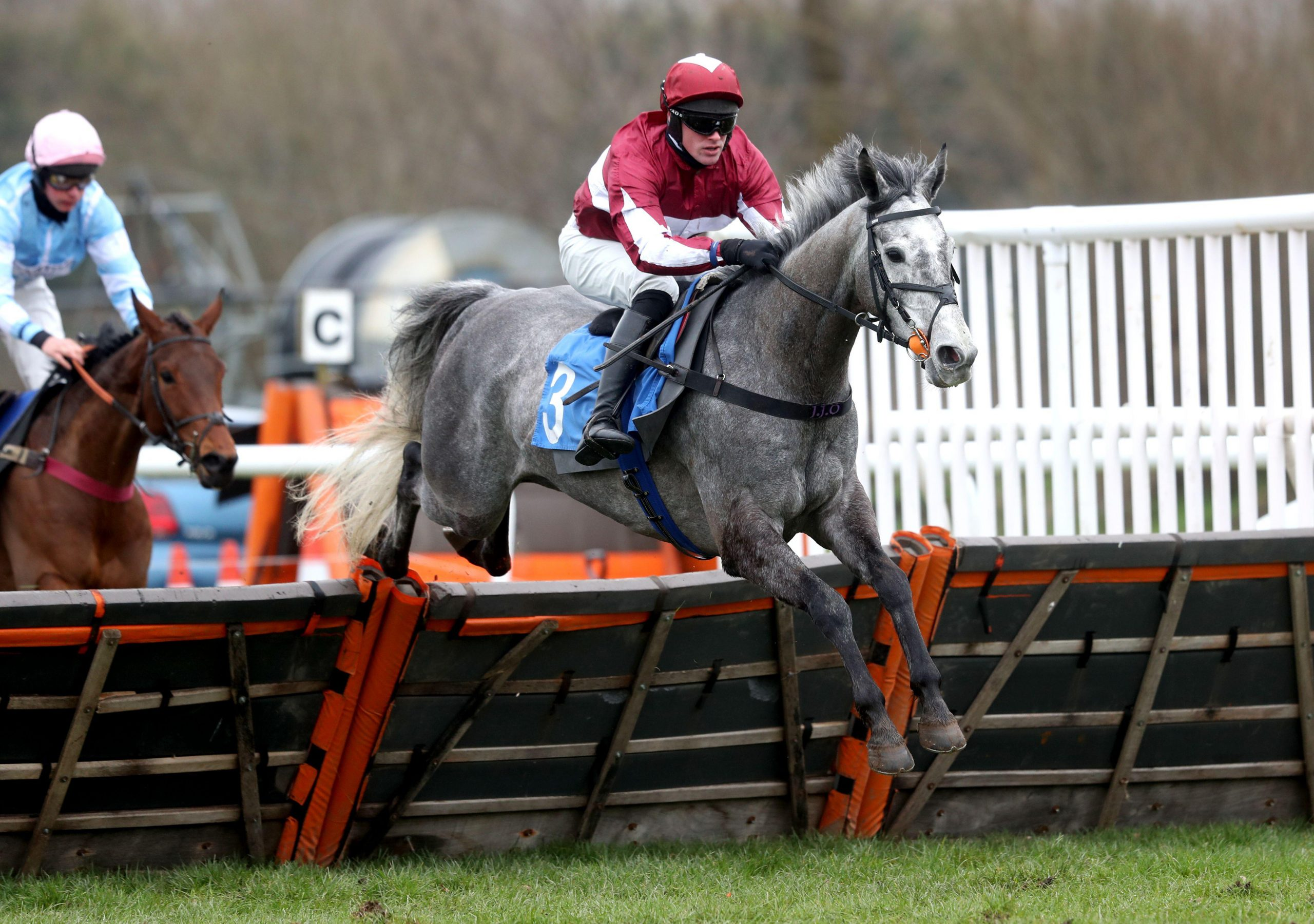 2EX733G An Tailliur ridden by Richie McLernon clears a fence whilst competing in the David Groom Sound Novices' Hurdle at Ludlow Racecourse. Picture date: Thursday March 4, 2021.