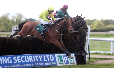 2FNW9JA Sugar Baron and Gina Andrews (right) coming home to win the Elizabeth Davenport Crudwell Cup Open Hunters' Chase ahead of Captain Cattistock and Albi Tufnell at Warwick Racecourse. Picture date: Wednesday May 19, 2021.