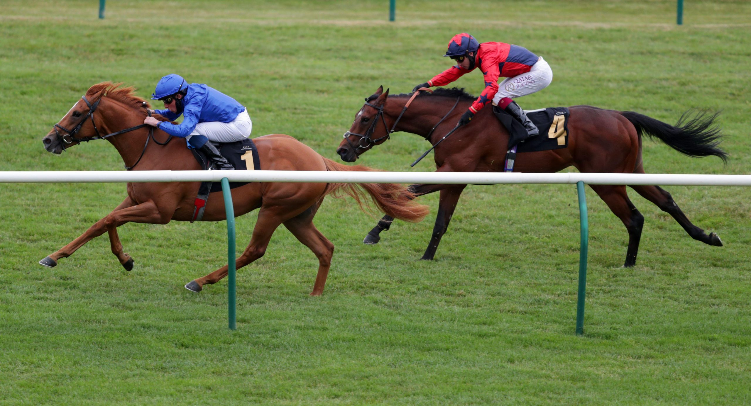 2BX1M5G Creative Force ridden by William Buick (left) wins the Betway Maiden Stakes (Div 2) at Newmarket Racecourse.