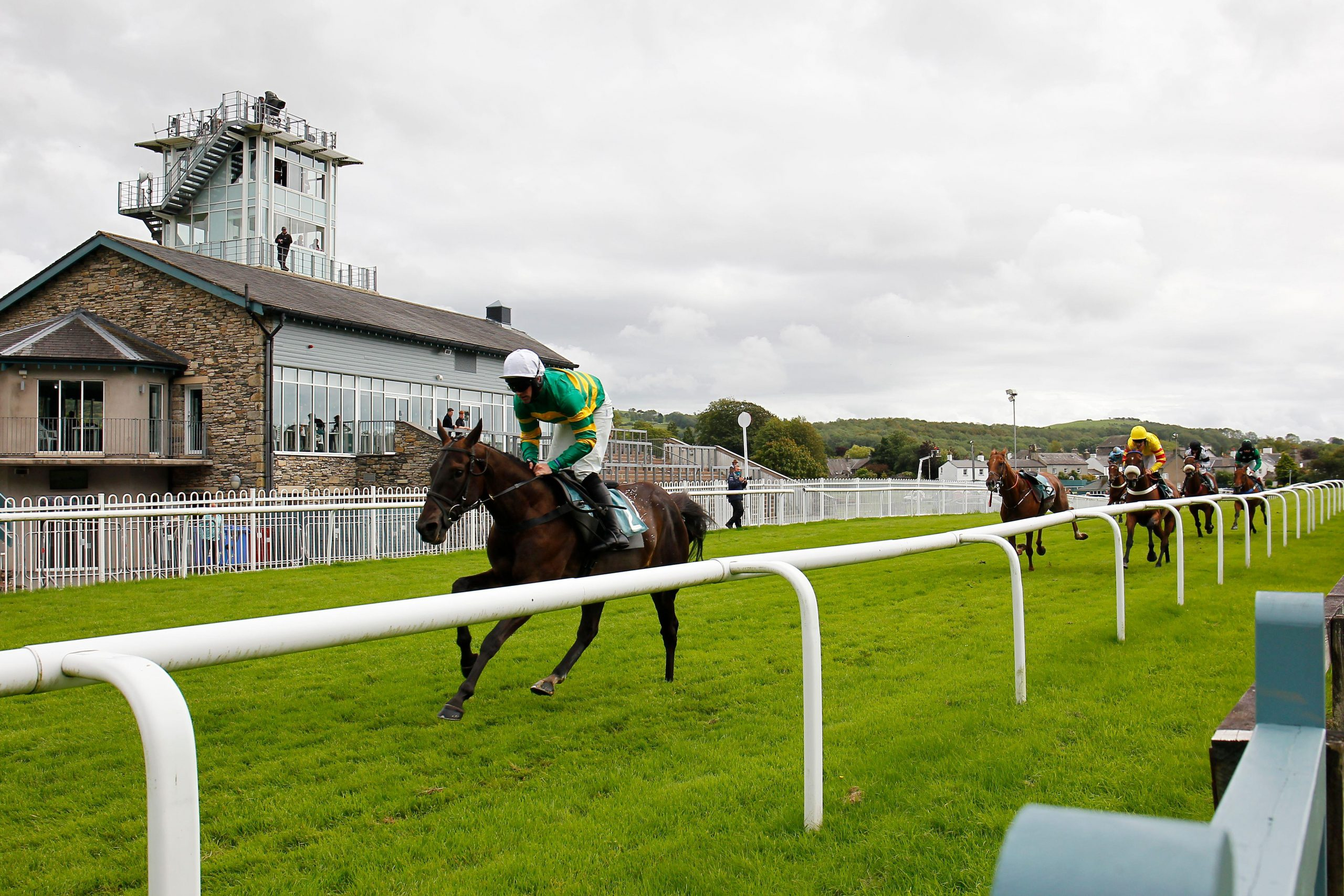 Demon D'Aunou and jockey Richie McLernon win the Unsworth Brewery Cartmel Novices' Handicap Chase at Cartmel Racecourse.