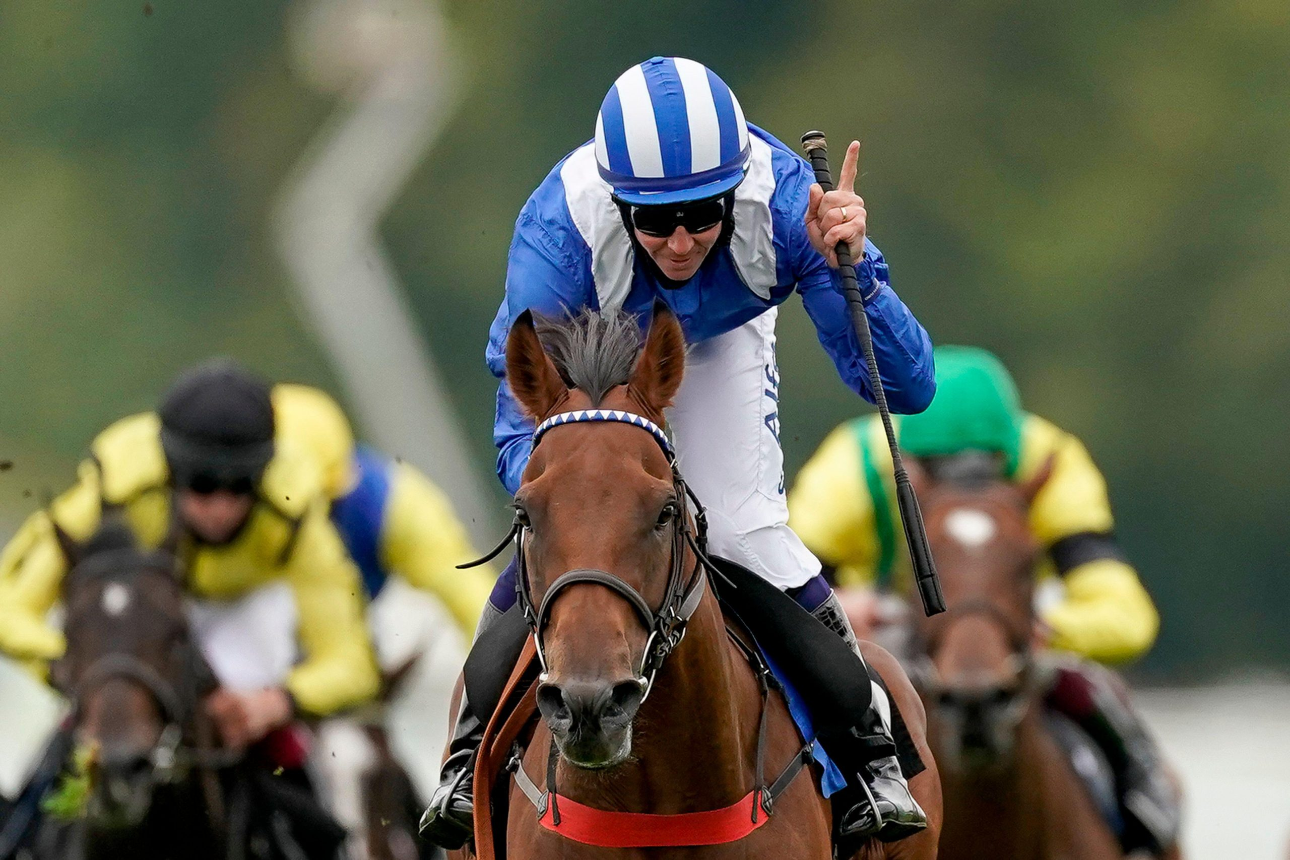 2CE0D60 Jim Crowley on board Modmin on their way to winning the The Ladbrokes Supporting 'Children With Cancer UK' Novice Stakes at Goodwood Racecourse, Chichester. Jim Crowley celebrates his two thousandth UK victory in National Hunt and Flat racing