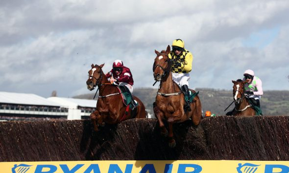 2B6Y2FN Samcro ridden by Davy Russel (left) and Melon ridden by Mr P W Mullins during the Marsh Novices Chase during day three of the Cheltenham Festival at Cheltenham Racecourse.
