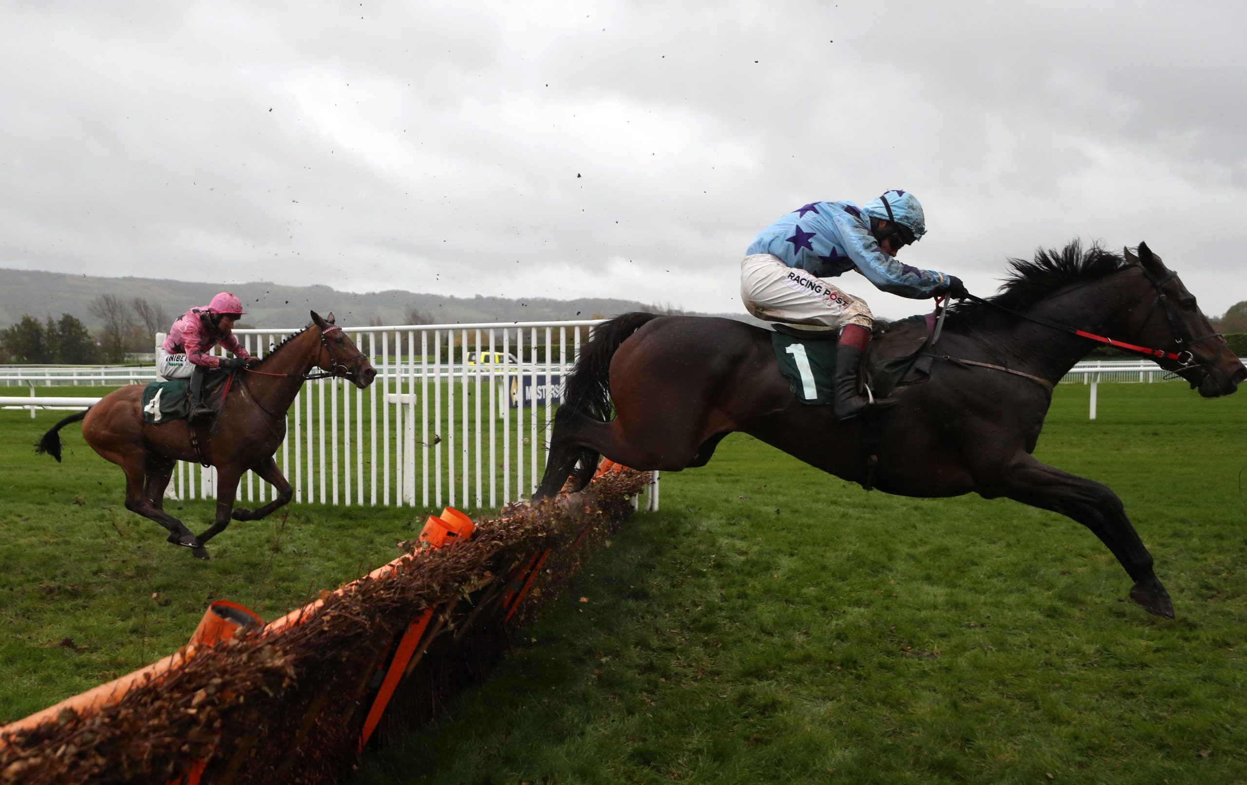 2D7NNA4 Streets Of Doyen ridden by Richard Johnson clears a fence before going on to win the Lara Telfer Reined In For Racing Welfare Novices' Hurdle at Cheltenham Racecourse.